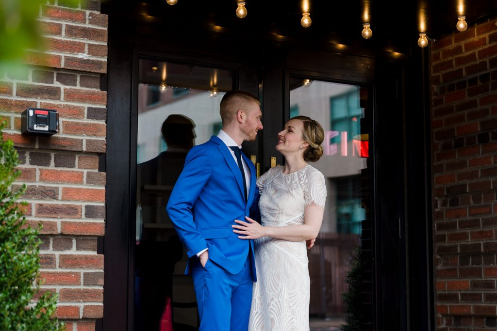 bride and groom on steps of dean hotel in providence
