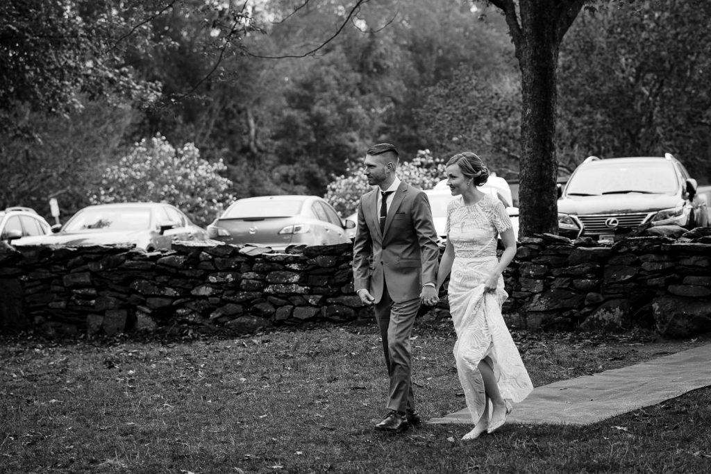 bride and groom walk to wedding ceremony