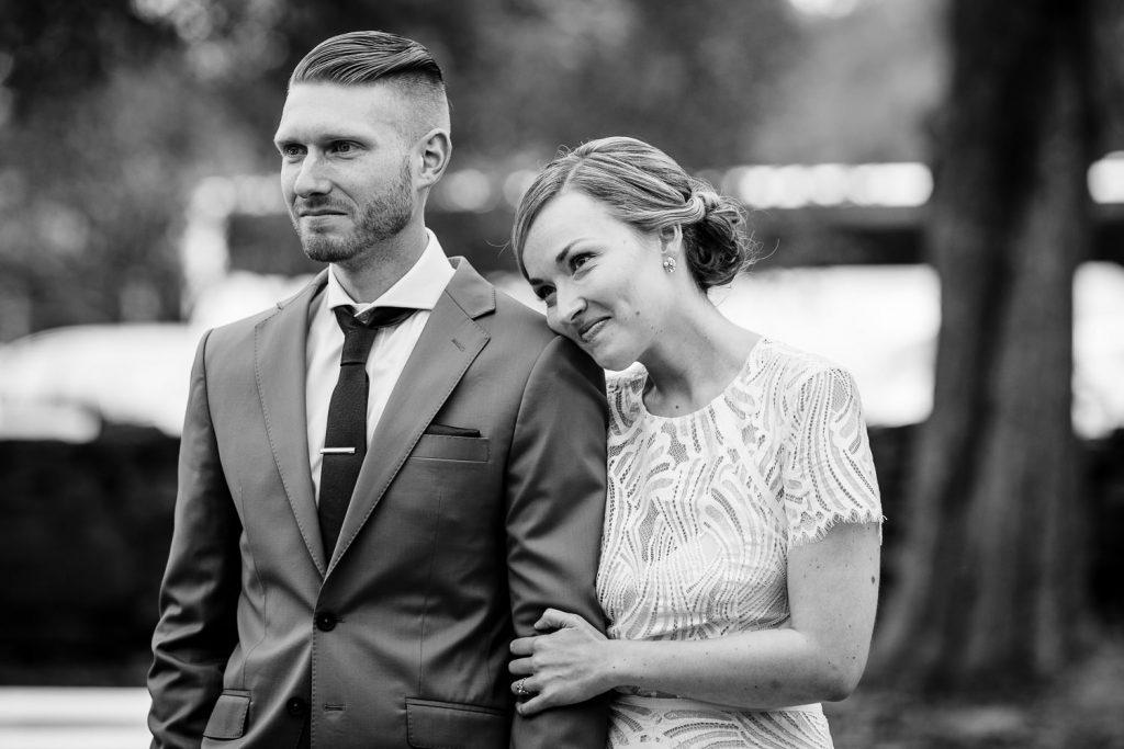 bride rests head on grooms shoulder