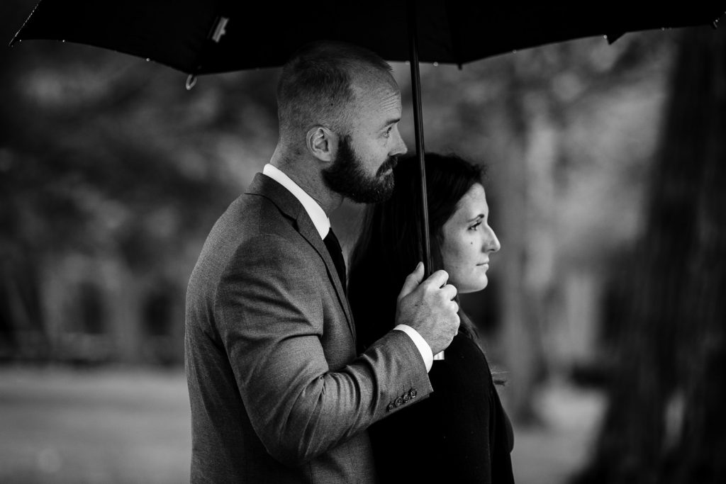 wedding guests under umbrella