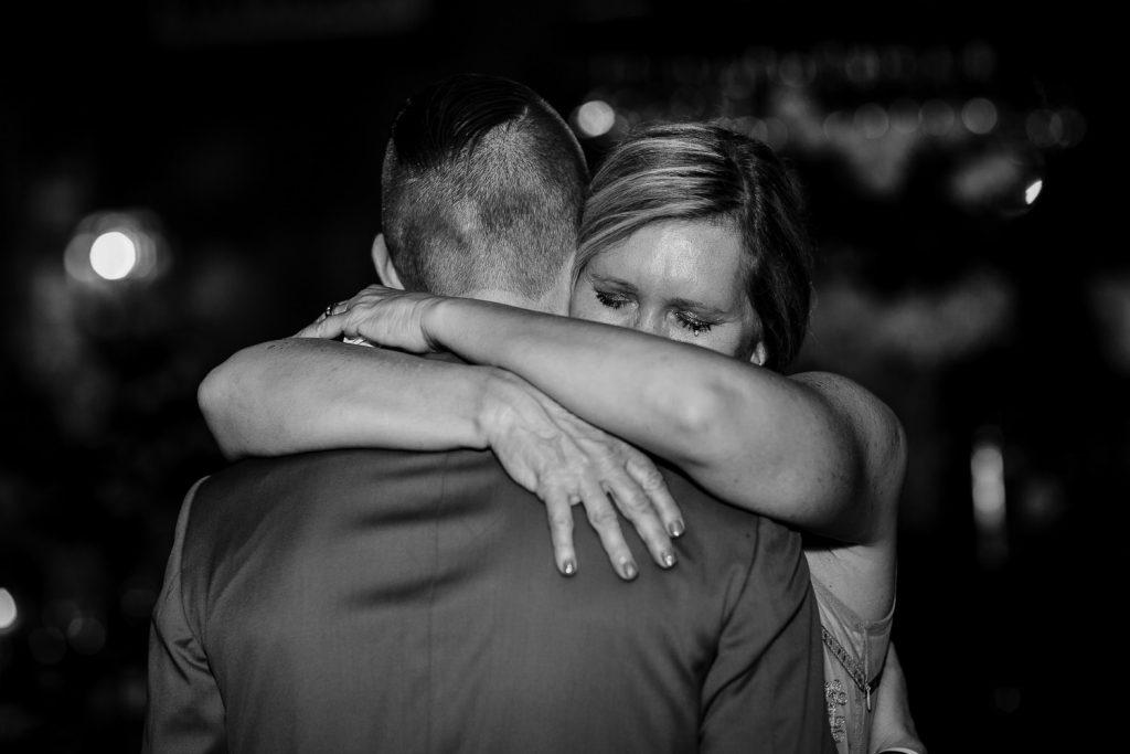 groom dancing with mom crying