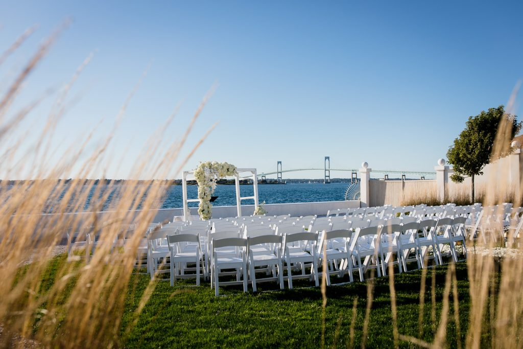 An outdoor wedding ceremony setup on the lawn at Belle Mer Newport