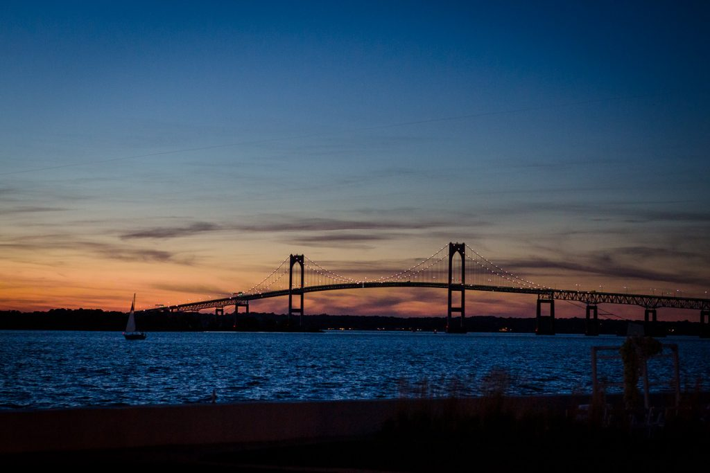 A view of the sunset over the Newport Bridge as seen from the Belle Mer wedding ceremony area