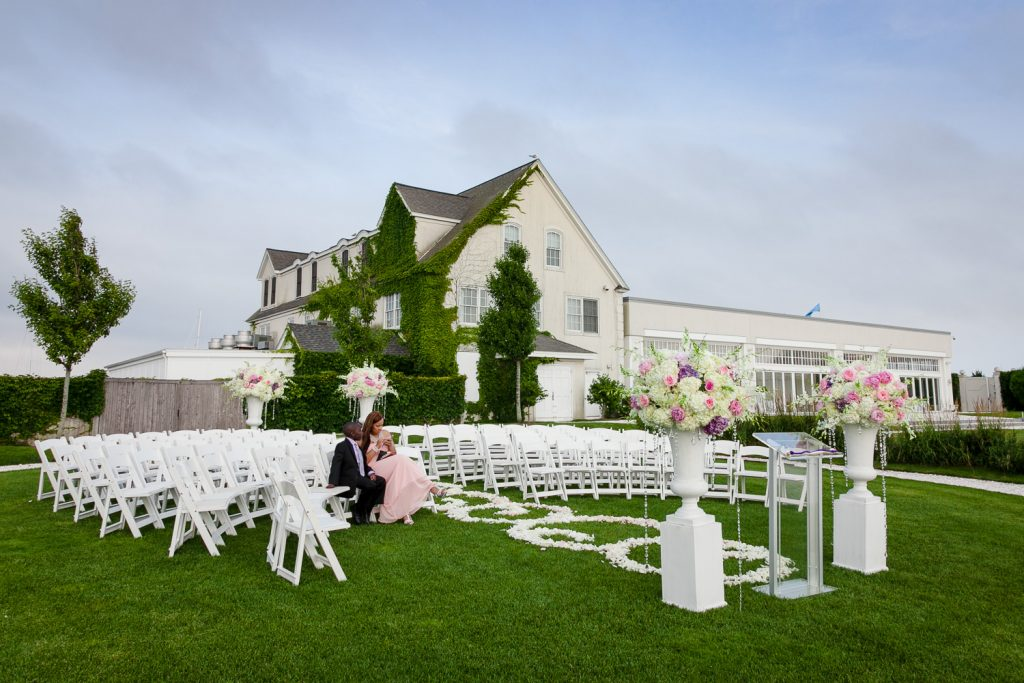 The outdoor wedding ceremony with the Belle Mer building in the background