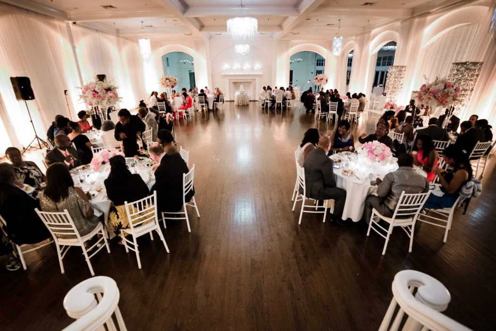 A view of a wedding reception in the Water Salon at a Belle Mer wedding