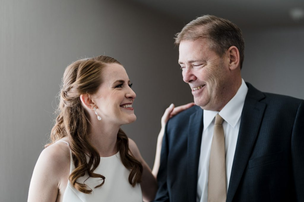 A bride and her father share a first look at the hilton mystic