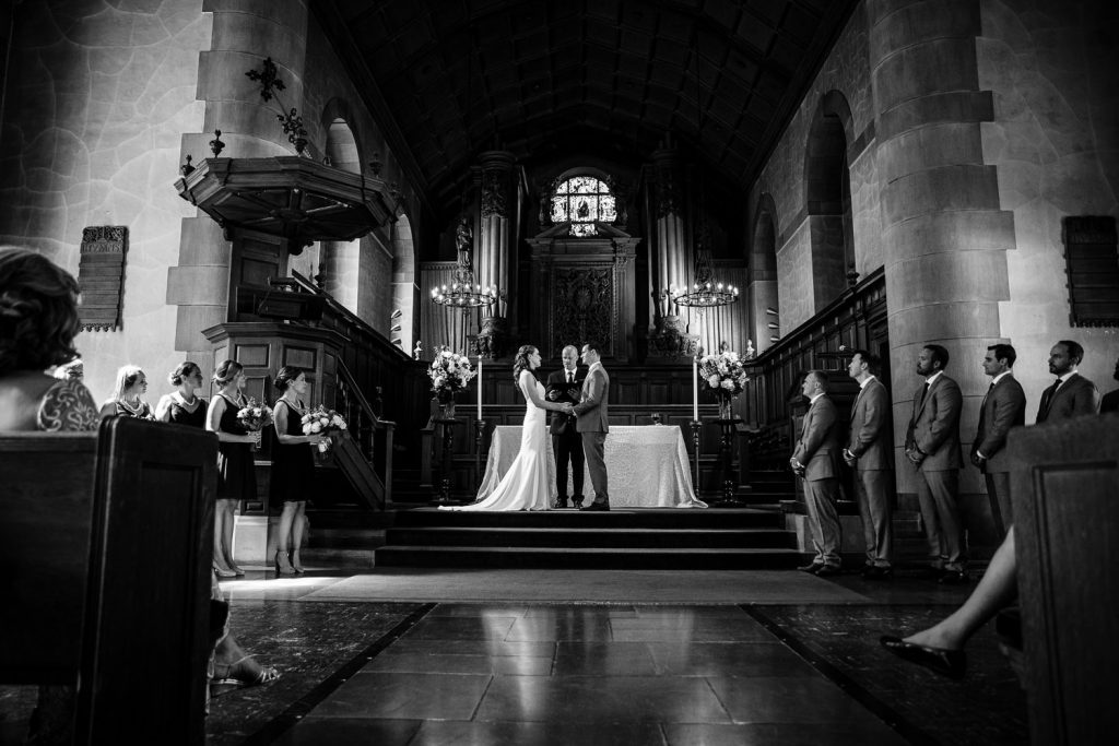 A bride and groom exchange vows at their harkness chapel connecticut college wedding ceremony