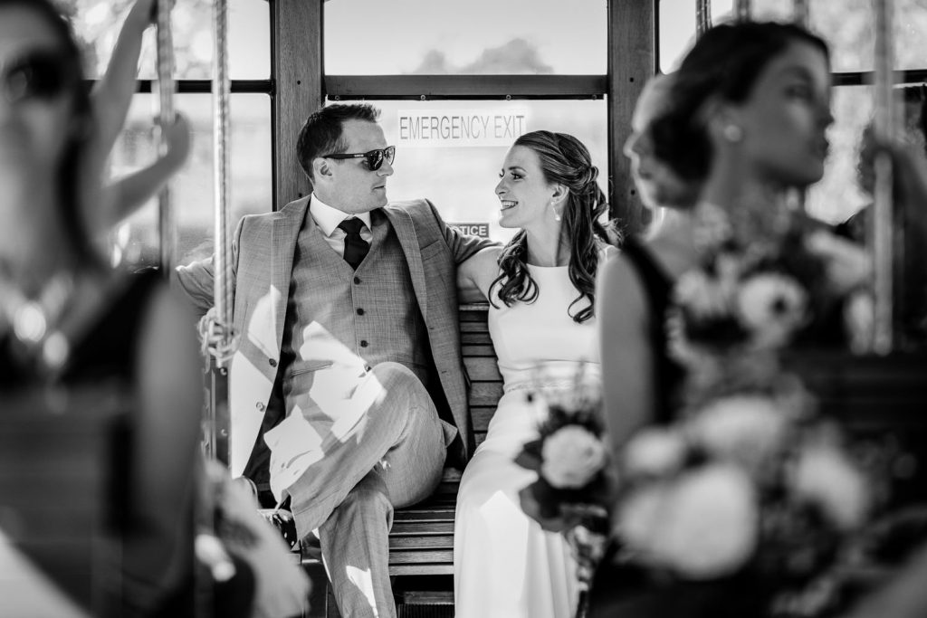 A bride and groom hang out on their wedding trolley