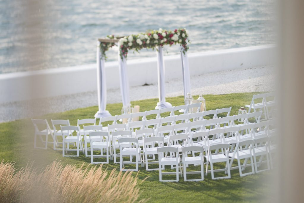 Wedding ceremony setup by the ocean at belle mer newport