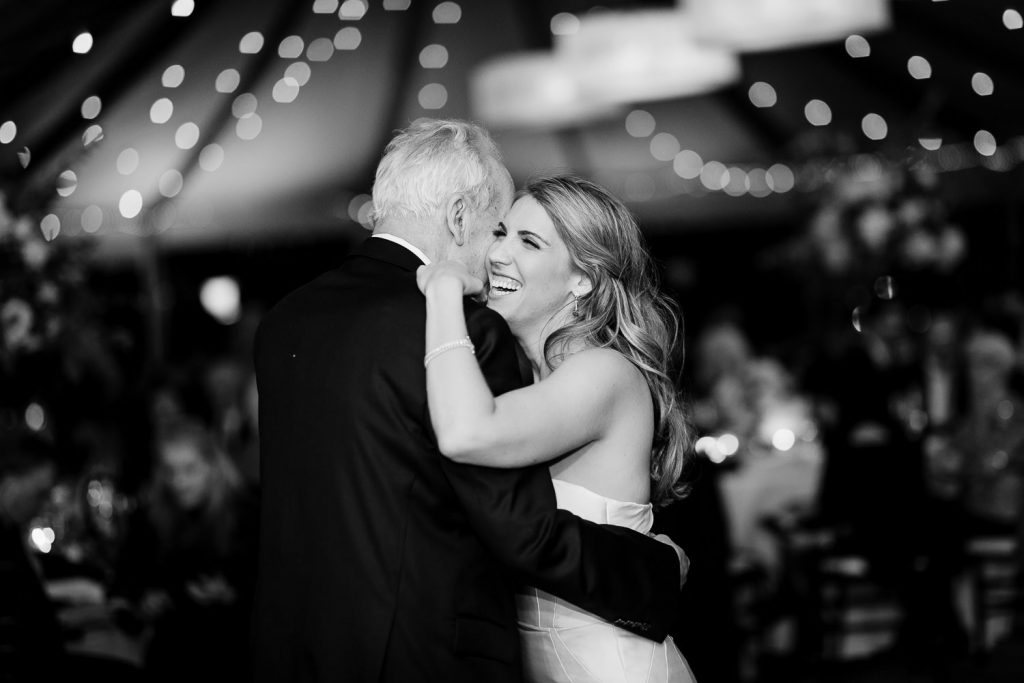 A bride dances with her father under the tent at her castle hill inn wedding