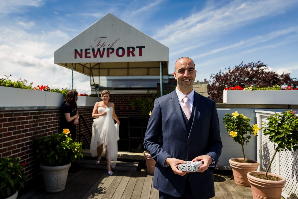 A bride and groom do a first look on the top of newport at the viking hotel
