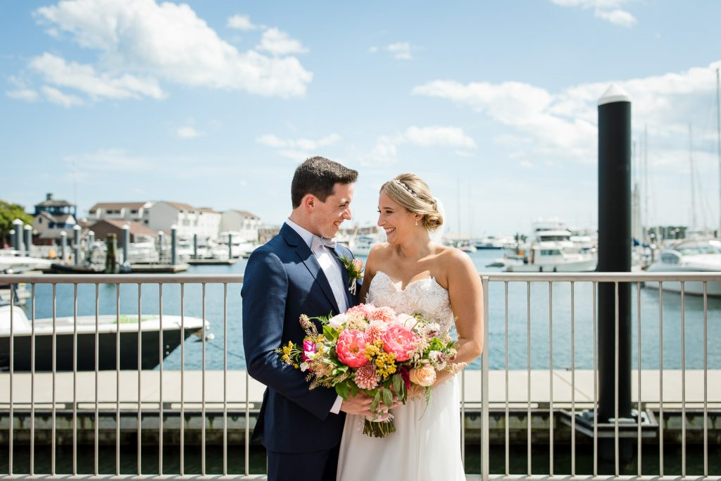 Bride and groom do a first look along the waterfront in newport ri