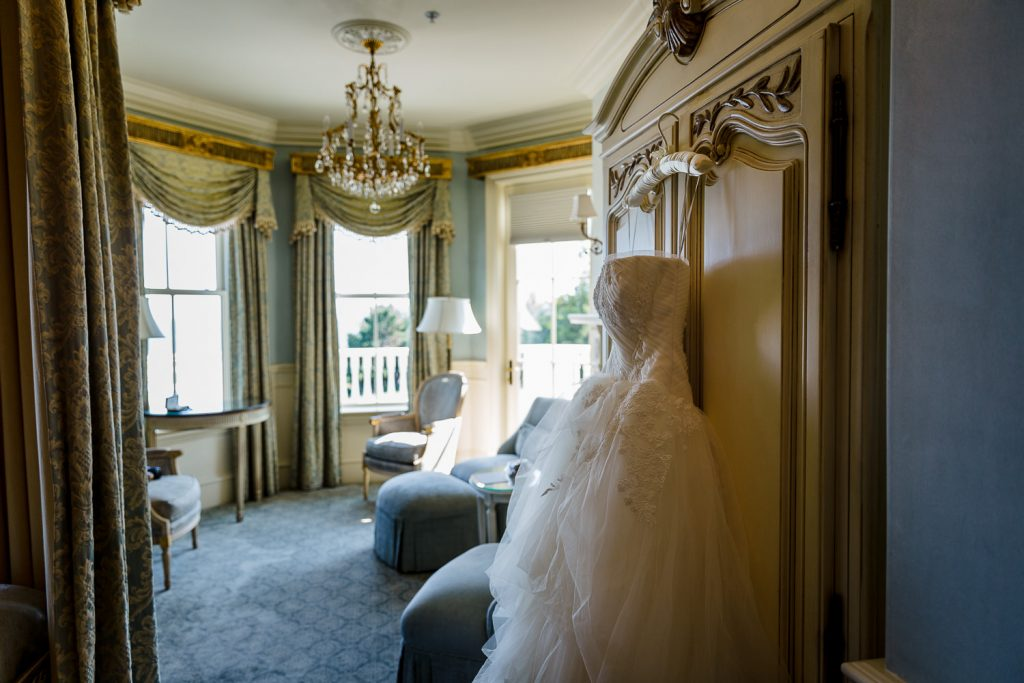 A wedding gown hangs in a hotel room at the chanler in newport