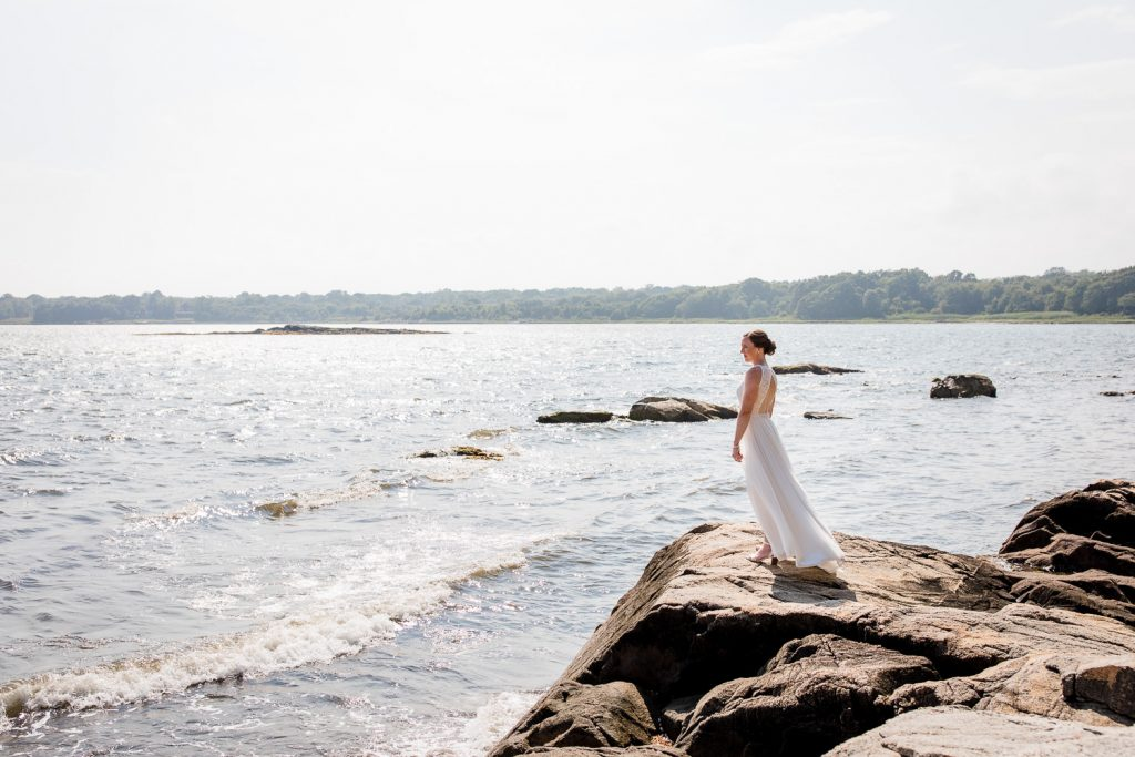 A bride standing on the rocks at mt hope farm