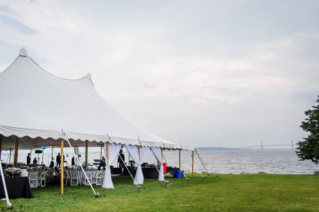 A wedding tent on the lawn at mount hope farm with the water in the background