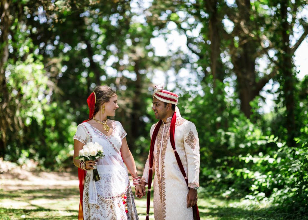 An indian bride and groom in the woods at mt hope farm