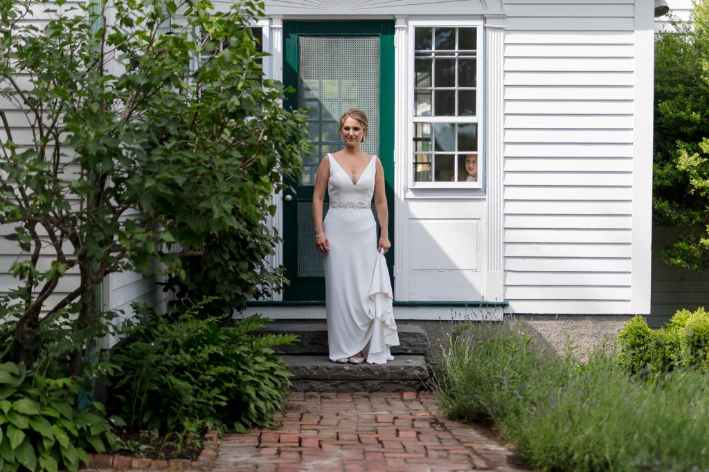 A bride leaves the Governor Bradford House at Mt Hope Farm