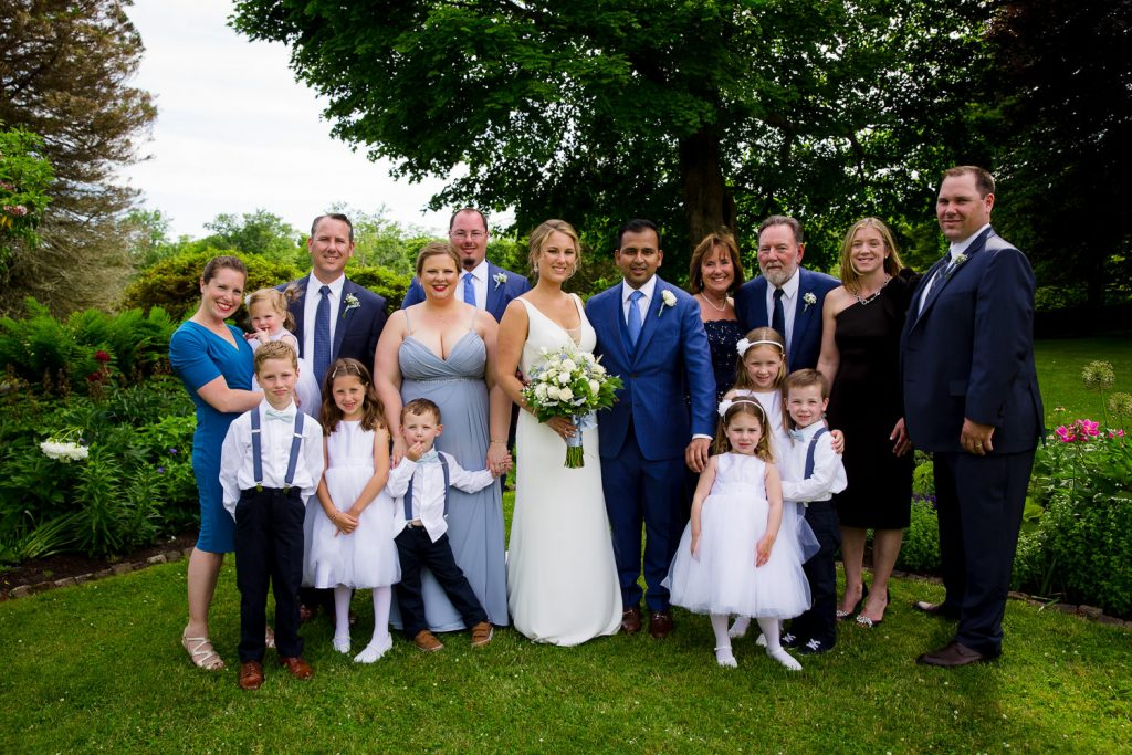 A large family wedding photo in the garden and mt hope farm