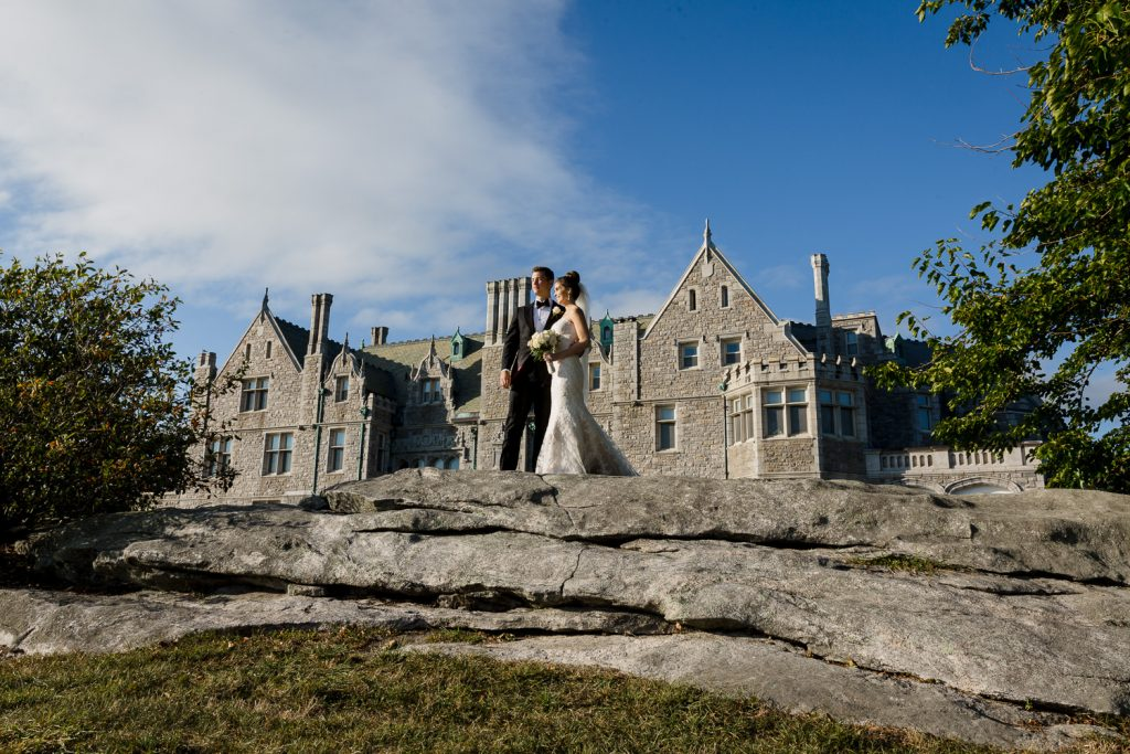 A couple pose on the boulders at branford house mansion