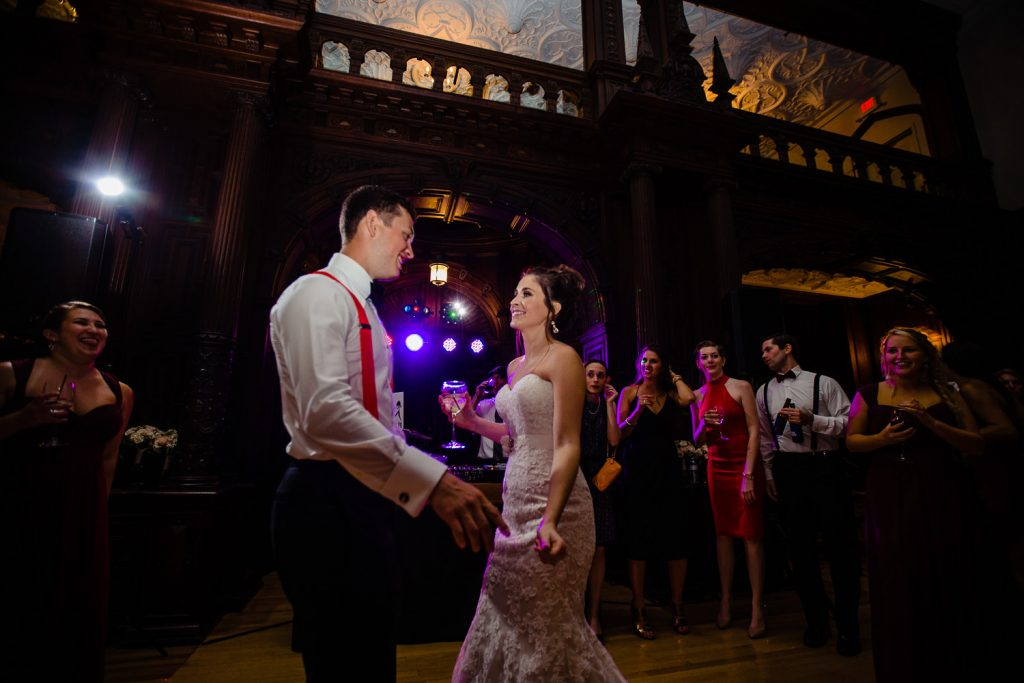 A bride and groom dance in the grand ballroom at their branford house wedding
