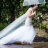 A bride walks barefoot in the rain to her Pomfret Chapel wedding