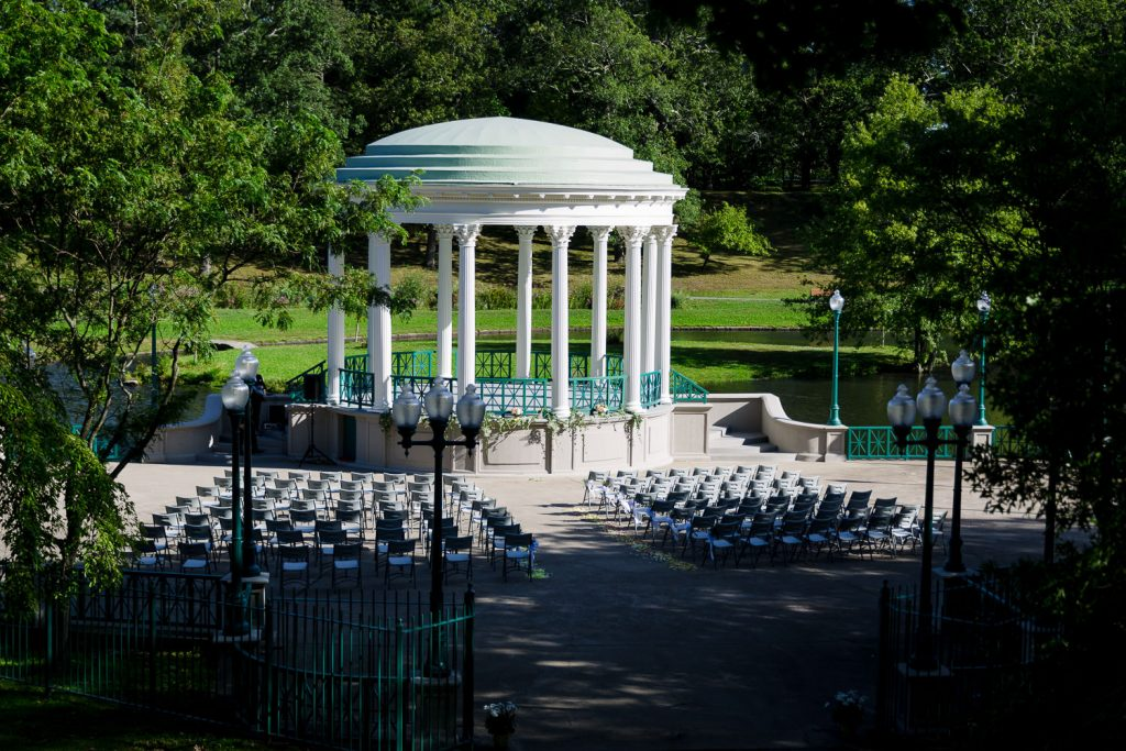 A wide view of chairs set up for a wedding ceremony at the Roger Williams Park gazebo