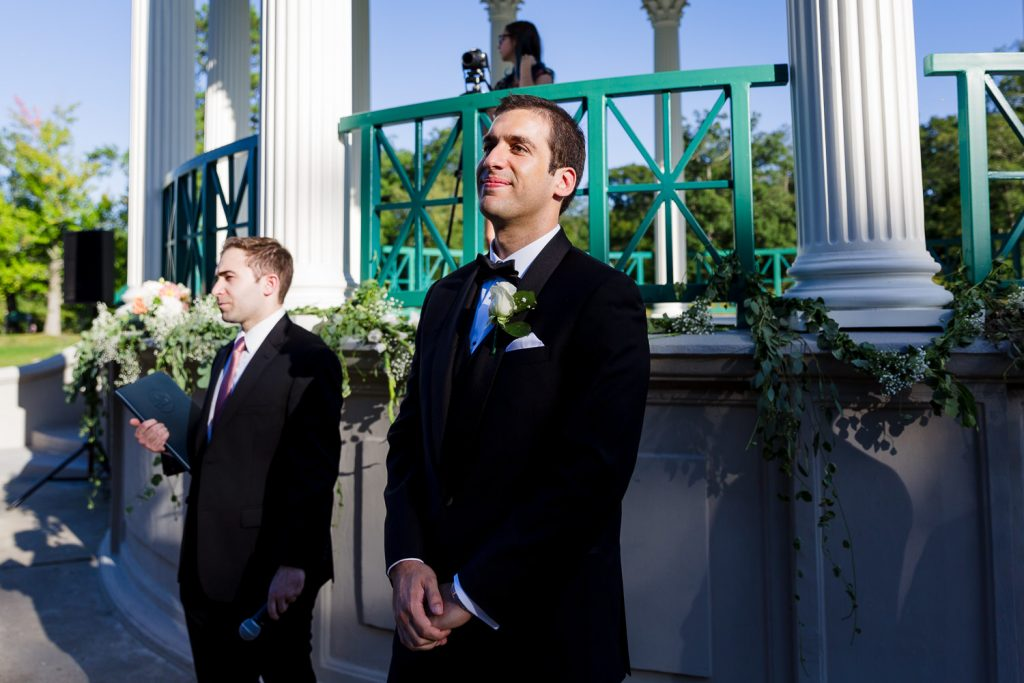 A groom waits for his bride to start their wedding ceremony