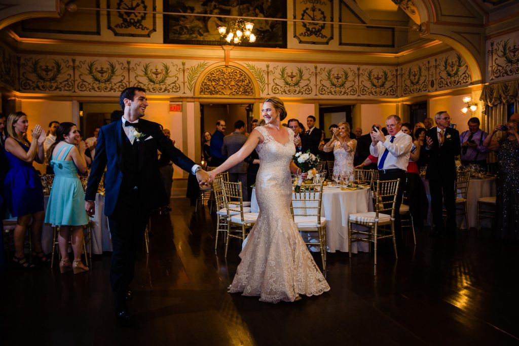 The bride and groom share a choreographed first dance at their wedding reception