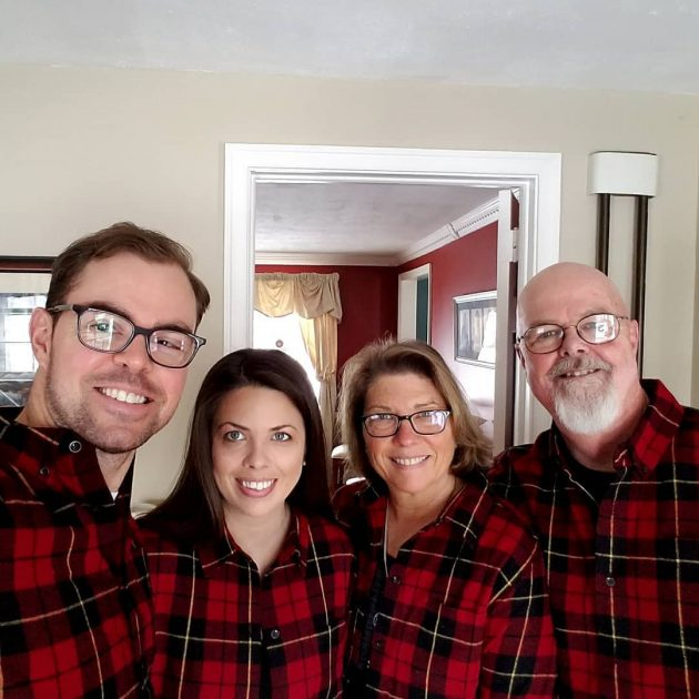 Two men and two women take a selfie wearing the wallace plaid shirts