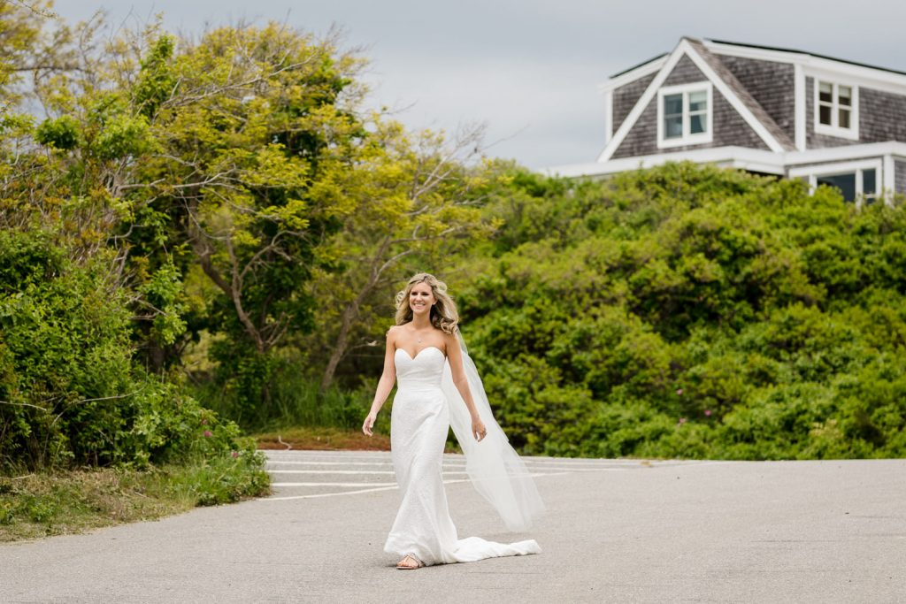 A bride walks to her wedding first look at Cold Storage Beach in Truro MA