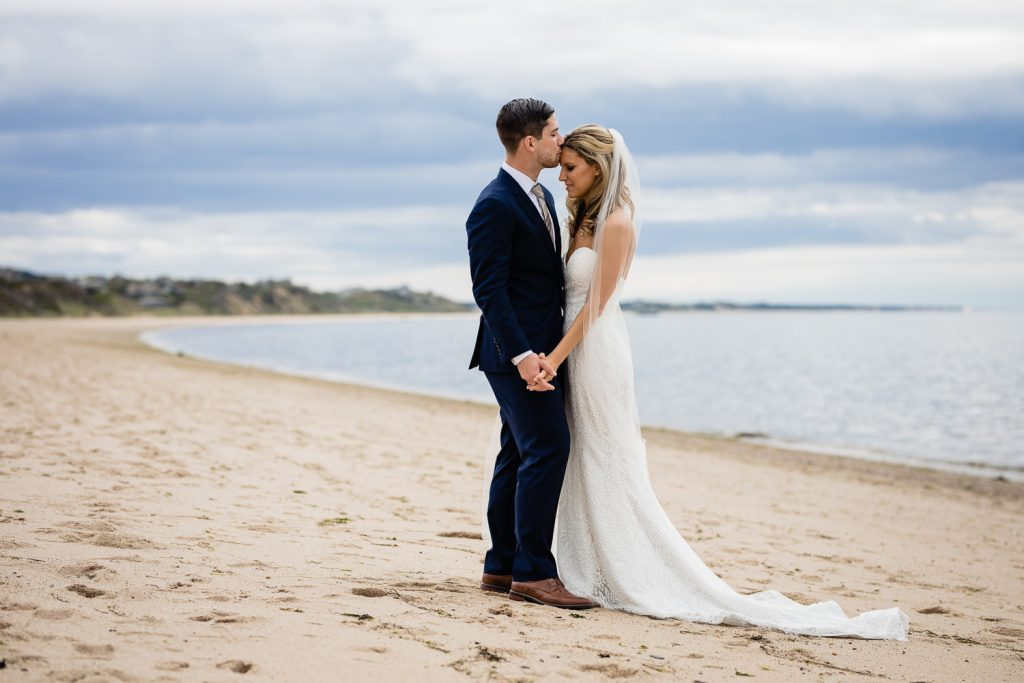 A bride and groom embrace on Cold Storage Beach in Truro, Cape Cod