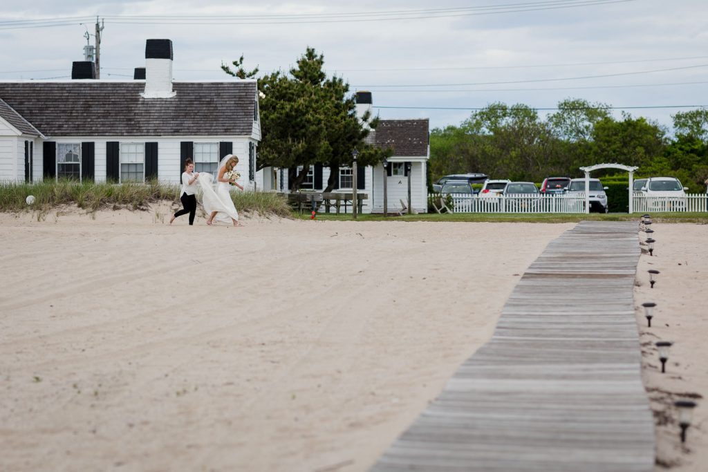 The bride processes from her cabin to the beach for her wedding