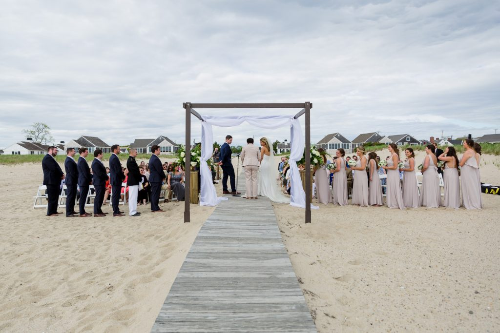 A wedding ceremony on the beach in cape cod