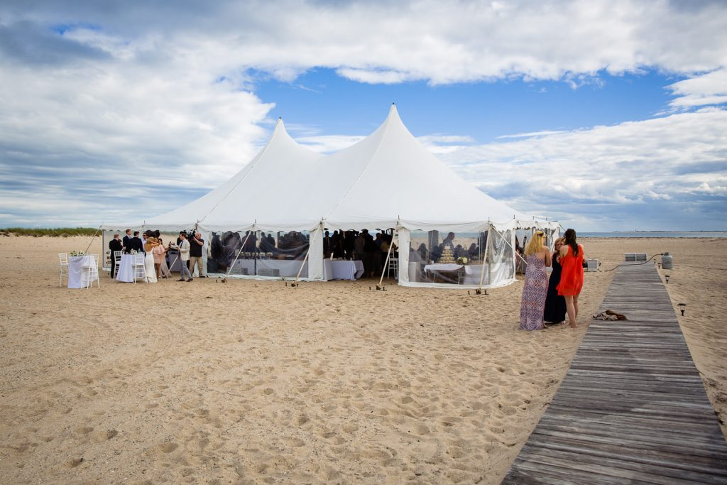 A wedding tent set up on the private beach at Kalmar Village on Cape Cod