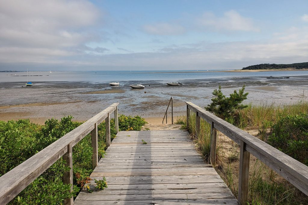 The boardwalk leading to the beach from Chequessett Yacht and Country Club boathouse wedding venue