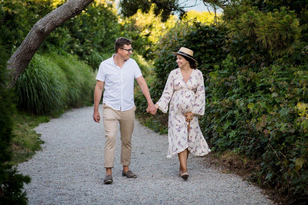 A pregnant couple walks the beach path in watch hill ri