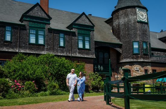 A couple walks the ground of the International Tennis Hall of Fame where their wedding would've taken place