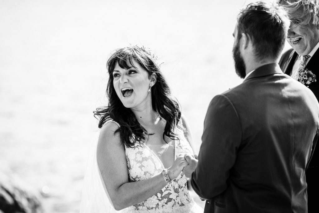A bride laughs during the wedding ceremony