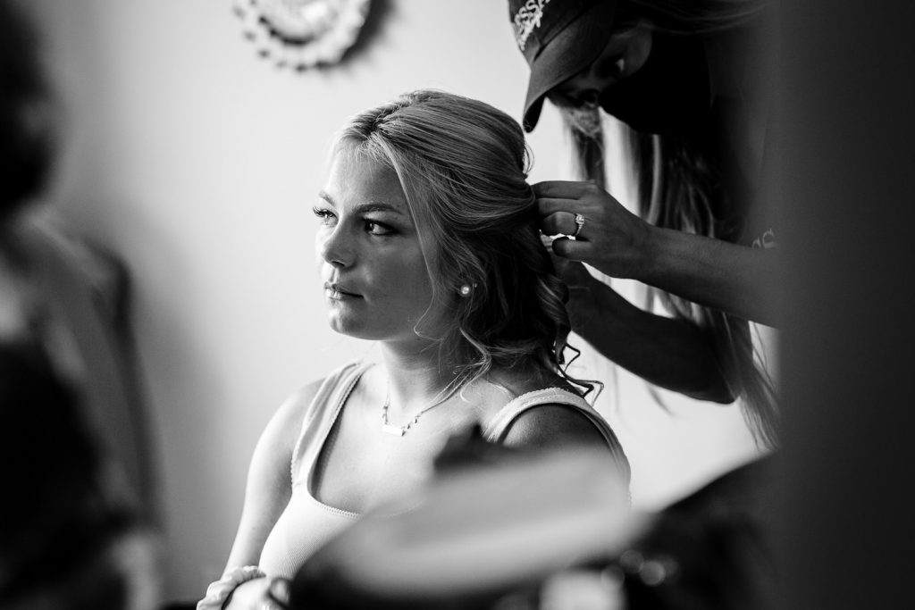 A woman gets her hair done before a wedding
