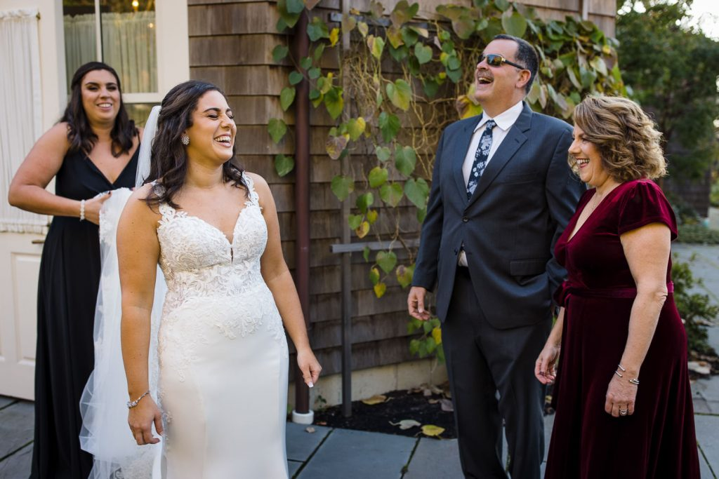 A bride and her family laugh together