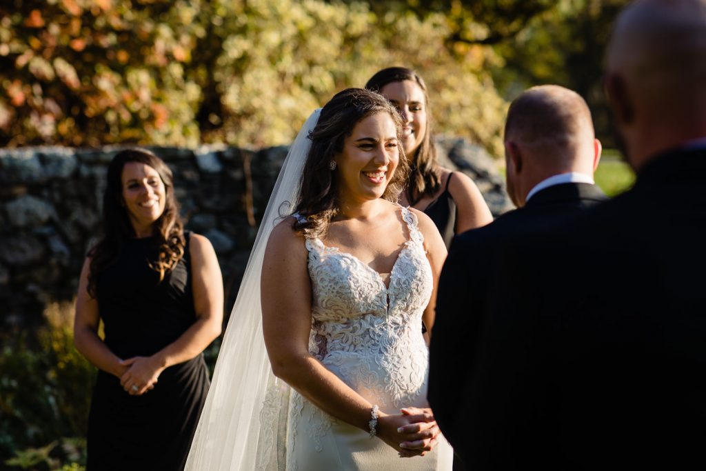 A bride laughs during her wedding ceremony
