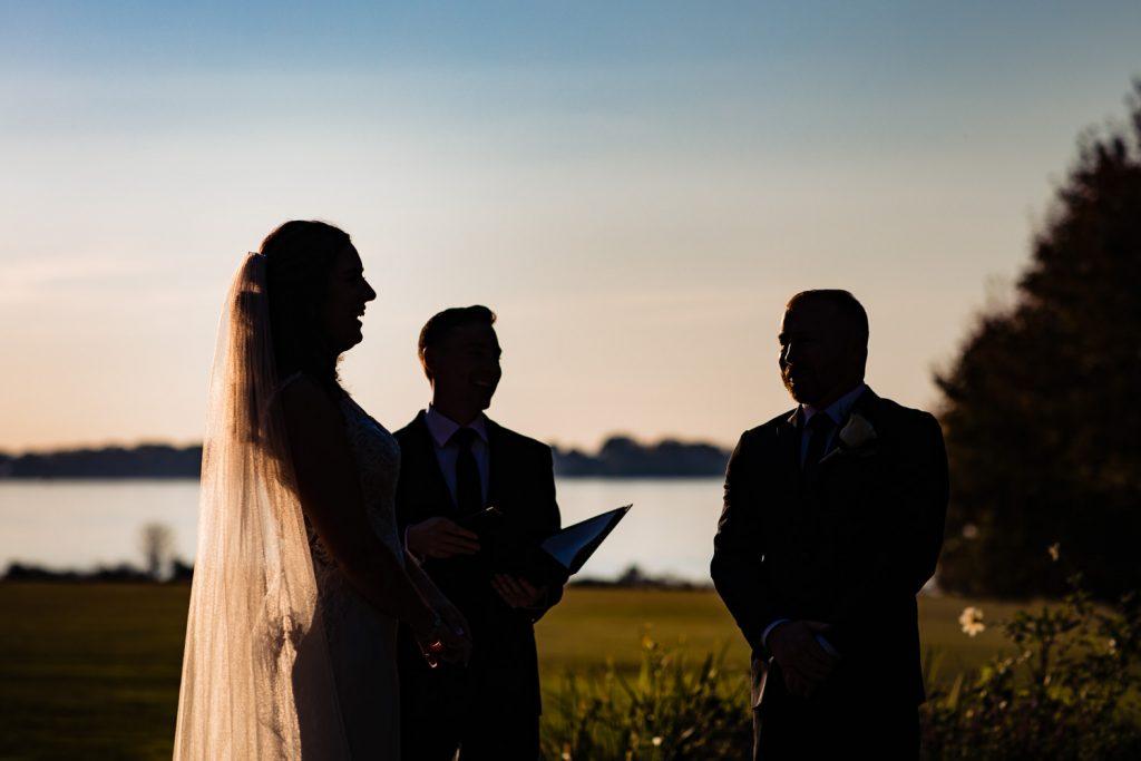 A bride laughs in silhouette