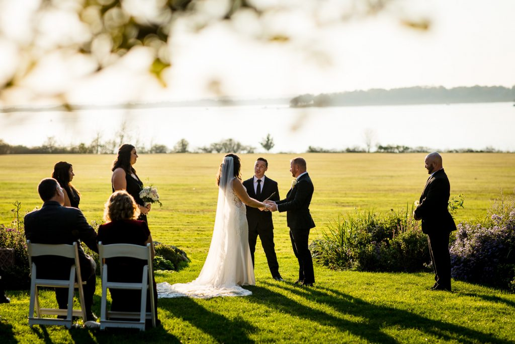 A bride and groom get married in the garden at blithewold mansion