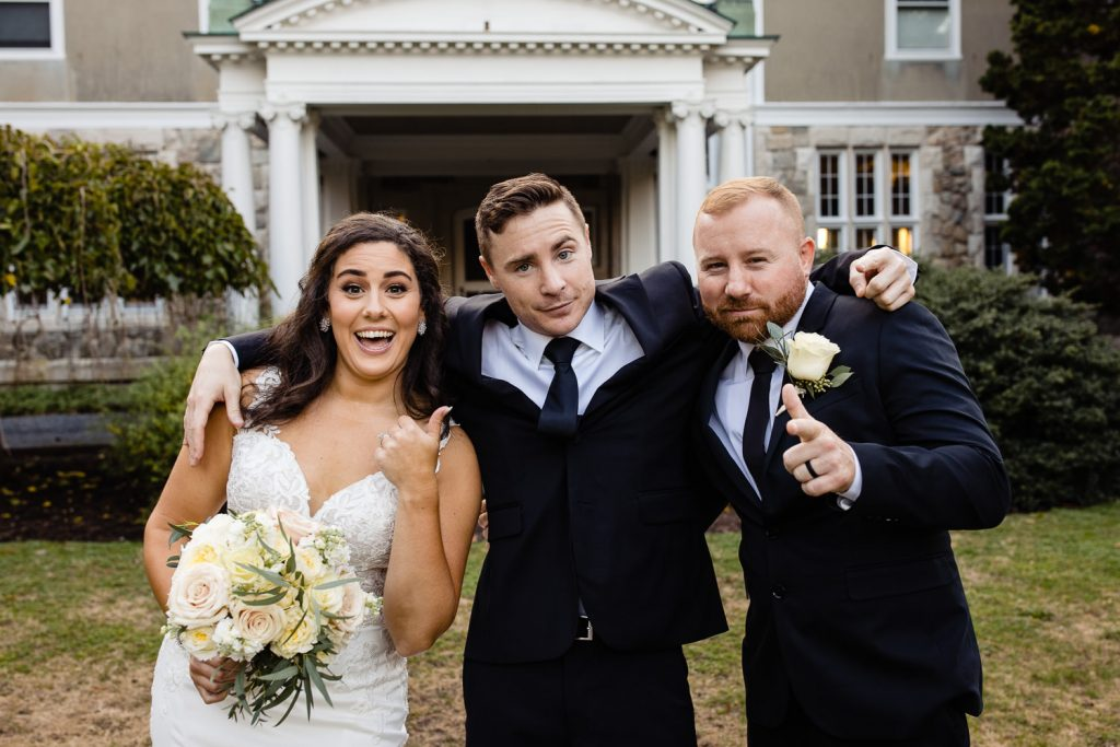 Fun formal photo of the bride, groom and their officiant