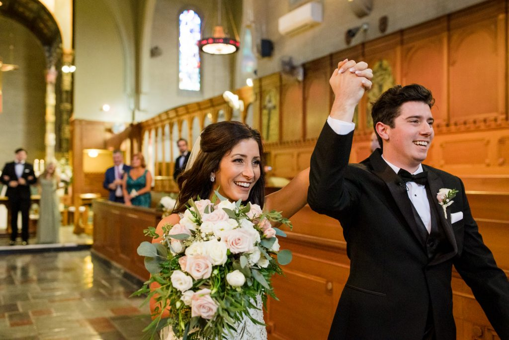 A bride and groom exit the aldrich mansion chapel after getting married